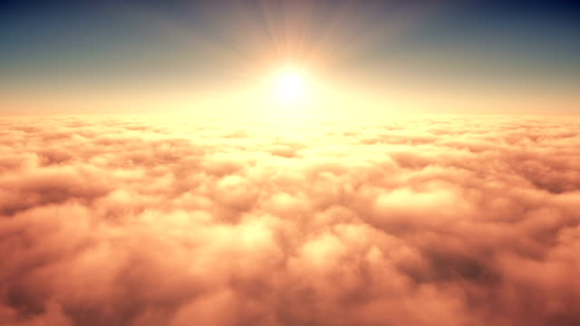 Flight Above The Clouds In The Rays Of Rising Sun. 4K.