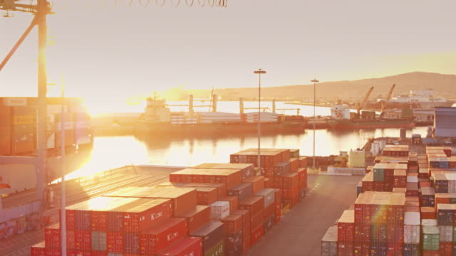 Flight Across Intermodal Shipping Yard at Sunset Drone shot of a yard filled with shipping containers in the port of Long Beach. commercial dock stock videos & royalty-free footage