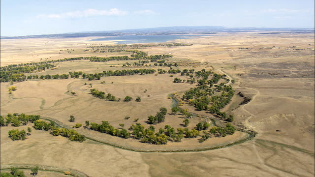 Flight Along Belle Fourche River Towards Keyhole Reservoir  - Aerial View - Wyoming, Crook County, United States video