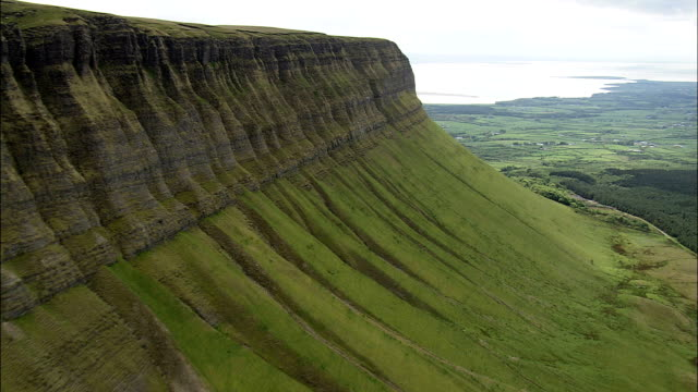 Flight Along Cliff Face Of Ben Bulben  - Aerial View - Connaught, County Sligo, Ireland This clip was filmed by Skyworks on HDCAM SR 4:4:4 using the Cineflex gimbal. grooved stock videos & royalty-free footage