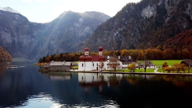 Flight around of St. Bartholomew's Pilgrimage church on Konigsee, Berchtesgaden, Germany video