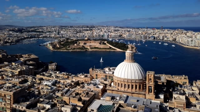 Flight around of Valletta old town and Cathedral of Saint Paul, Malta Aerial view of Valletta, Malta malta stock videos & royalty-free footage