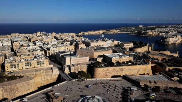 Flight around of Valletta old town and City Gate, Malta Aerial view of Valletta, Malta malta stock videos & royalty-free footage