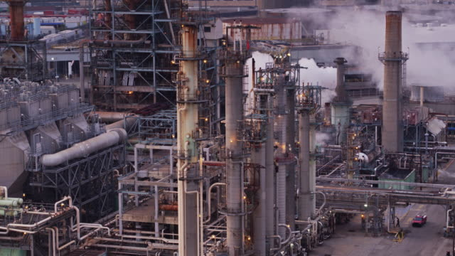 Flight Around Row of Distillation Tower in Oil Refinery – film