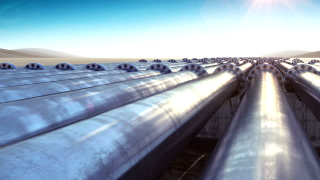 Flight at Many Pipelines. Looped 3d animation. HD 1080. Steel Pipelines. Technology and Transportation Business Concept. Blue Sky and Sun Shining. video