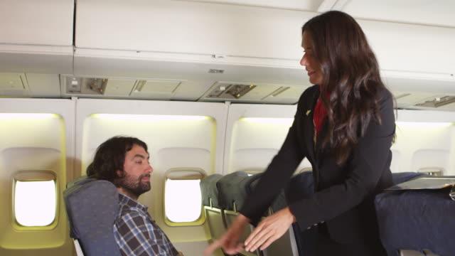 Flight attendant instructing safety procedures video