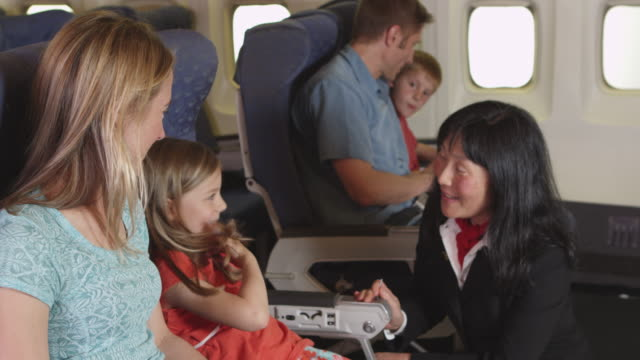 Flight attendant speaking to child on plane video
