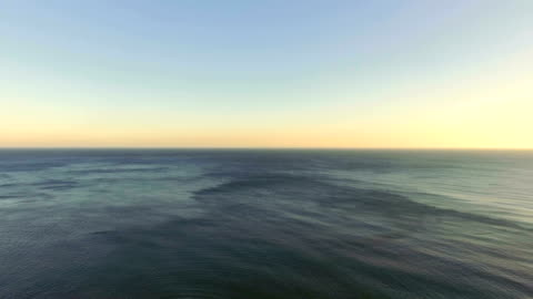 Flight from sea shore, aerial video AERIAL: Rippled sea surface with blue water horizon stock videos & royalty-free footage