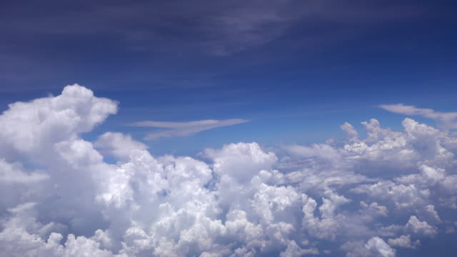 4K Flight in the clouds blue sky