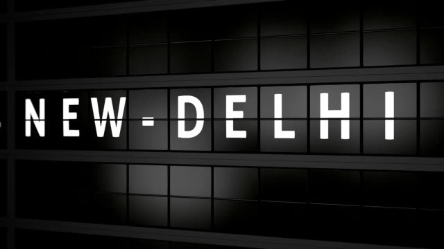 flight information board with the city name New Delhi video