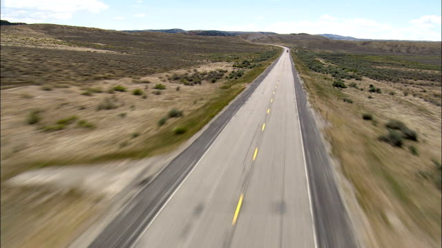 Flight Low And Fast Down Route 789  - Aerial View - Wyoming,  Fremont County,  helicopter filming,  aerial video,  cineflex,  establishing shot,  United States video