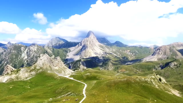 Flight Over a Green Valley in the Alps, Aerial View