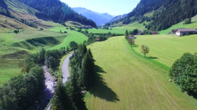 flight over a river, valley in the alps, aerial view
