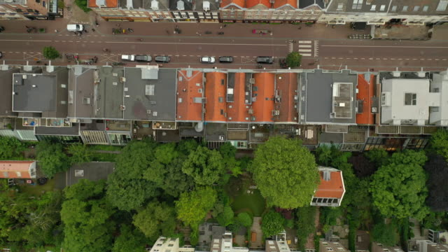stockvideo's en b-roll-footage met vlucht over amsterdam city living district luchtfoto topdown panorama 4k nederland - vierkant compositie