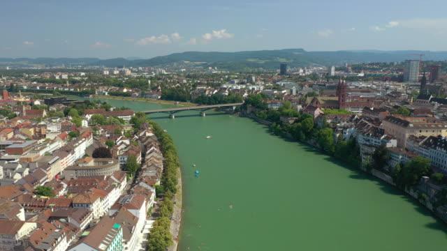 flight over basel cityscape summer day river traffic aerial panorama 4k switzerland - vídeo