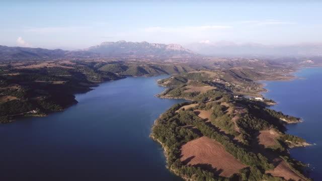 flight over beautiful lake in greece - пелопоннес стоковые видео и кадры b-roll