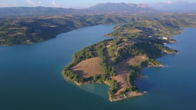 flight over beautiful lake pineos in greece - пелопоннес стоковые видео и кадры b-roll