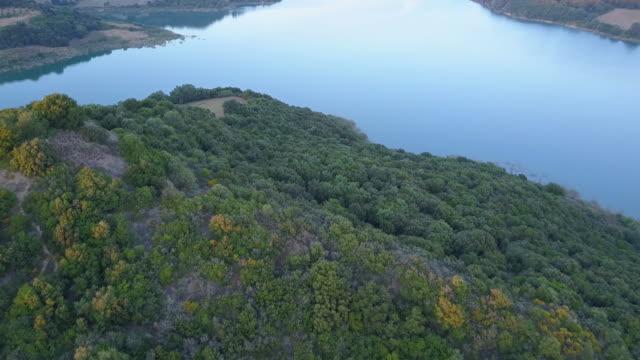 flight over beautiful lake pineos on sunset. greece. - пелопоннес стоковые видео и кадры b-roll