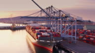 istock Flight Over Cargo Ship at Sunset in Port of Long Beach 918314666