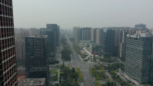 flight over chengdu city downtown traffic street crossroad aerial panorama 4k china - vídeo