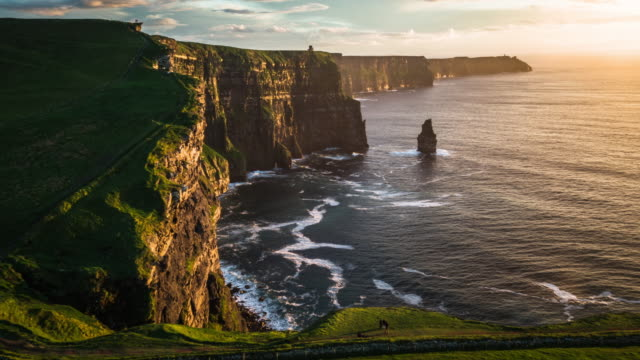 flight over cliffs of moher at sunset, ireland - landscape video stock e b–roll