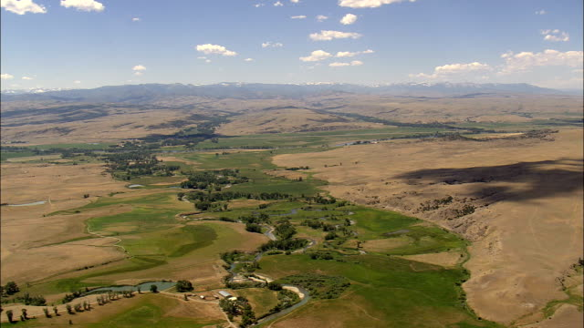 Flight Over Cloud Shadows To Yellowstone River  - Aerial View - Montana, Sweet Grass County, United States video