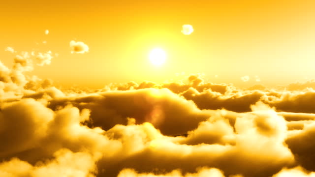 Flight over clouds, yellow sunset video