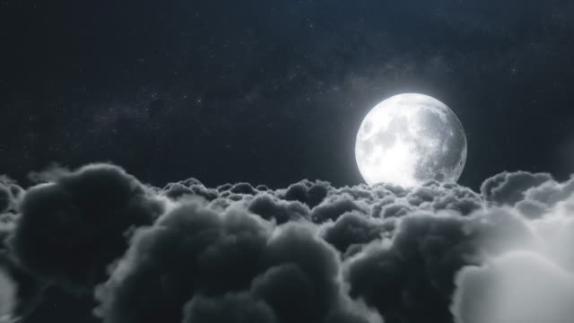 Flight over cumulus lush clouds in the night moonlight video