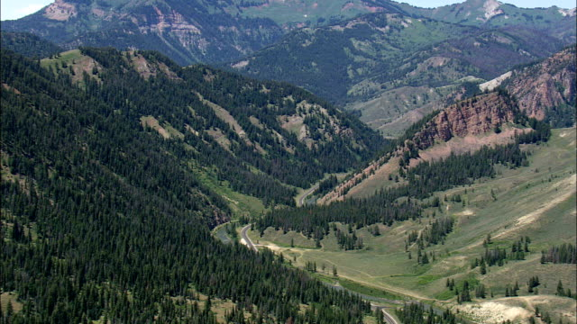 Flight Over Escarpment To Reveal Jackson In Background  - Aerial View - Wyoming,  Teton County,  helicopter filming,  aerial video,  cineflex,  establishing shot,  United States video