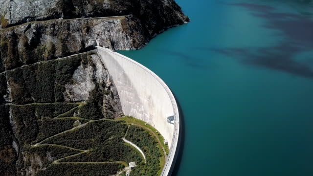 Flight over Kolnbrein Dam and Kolnbreinspeicher lake in Carinthia, Austria.