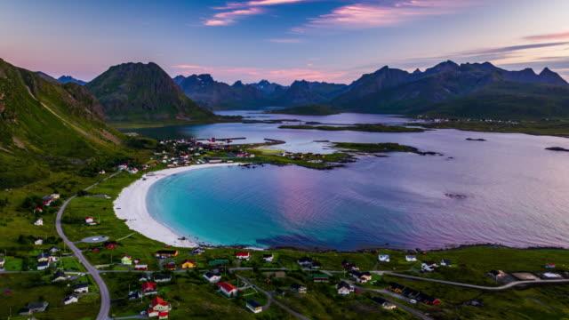 vídeos de stock e filmes b-roll de flight over lofoten islands landscape with untouched beach, ramberg, norway - lofoten