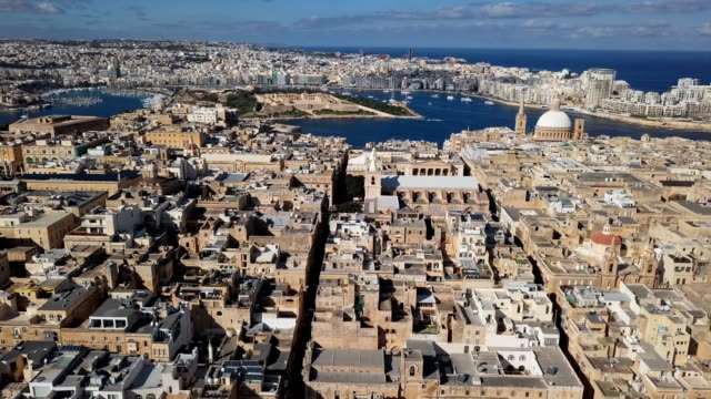 Flight over of Valletta old town and Cathedral of Saint Paul, Malta Aerial view of Valletta, Malta malta stock videos & royalty-free footage