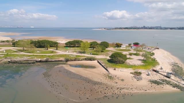 vídeos de stock e filmes b-roll de flight over peninsula with beachs near city - ilha da madeira