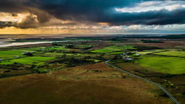 Flight over rural landscape in Ireland at Sunset video