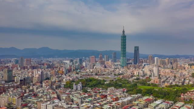 flight over taipei city downtown sunny day aerial panorama 4k timelapse taiwan