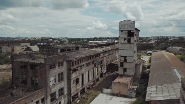Flight over the destroyed factory. Flight over the destroyed factory. Old industrial building for demolition. Aerial view abandoned stock videos & royalty-free footage