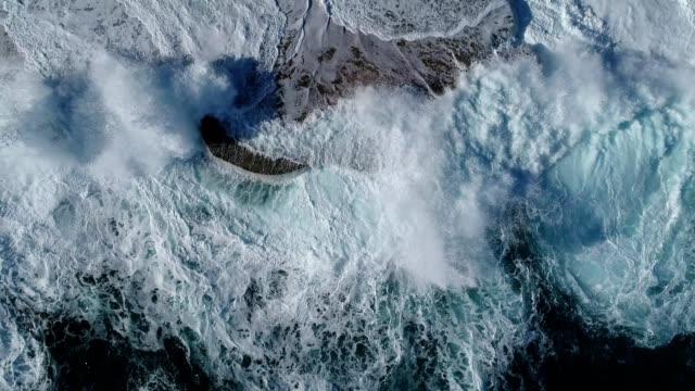 flight over the green waves that beat the rocks in montenegro - burza filmów i materiałów b-roll
