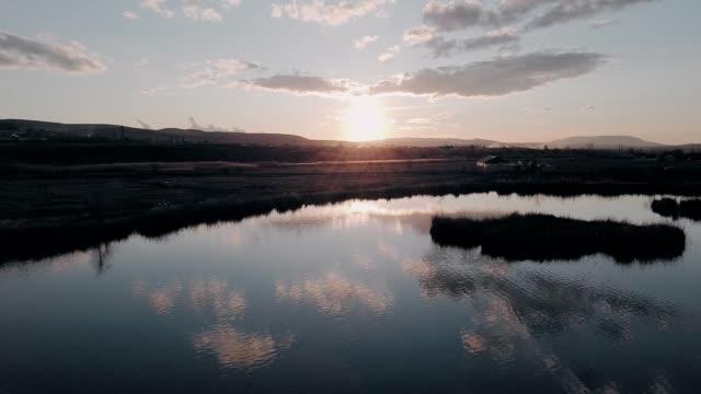 Flight over the lake during sunrise