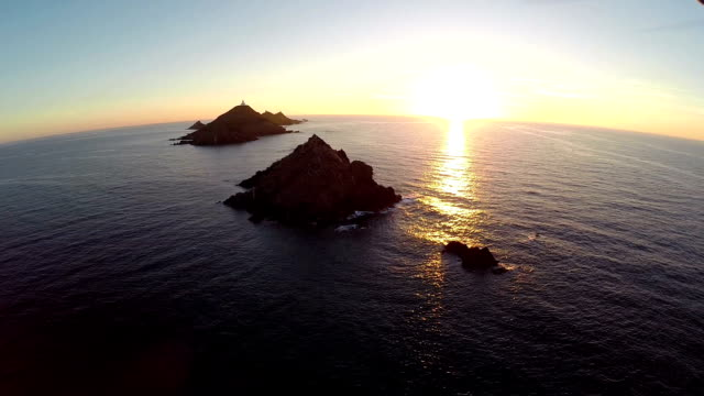 Flight over the sea and islands at sunset, Ajaccio area, Corsica, France. Aerial panoramic view. video