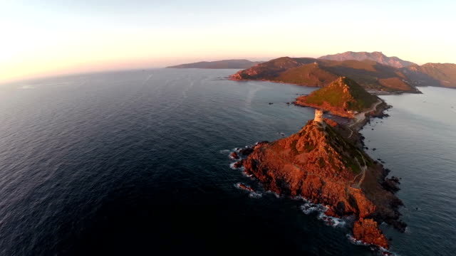 Flight over the sea and islands at sunset. Tour de la Parata, Ajaccio area, Corsica, France. Aerial panoramic view. video