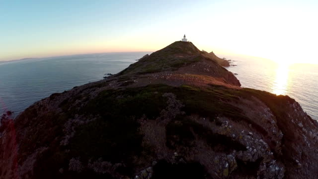 Flight over the sea and islands with lighthouse at sunset, Ajaccio area, Corsica, France. Aerial view. video