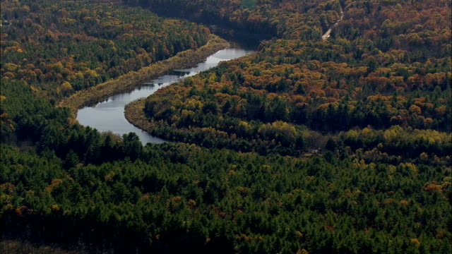 Flight Past River Leading To Drew Lake  - Aerial View - New Hampshire,  Hillsborough County,  United States video