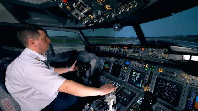 A flight simulator is demonstrating taking-off process under instructor's control A flight simulator is demonstrating taking-off process under instructor's control. 4K cockpit stock videos & royalty-free footage