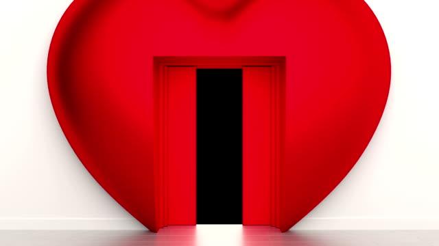 Flight through opening heart shaped elevator door. video