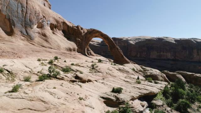 4K AERIAL: Flight through sandstone arch video