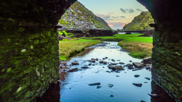Flight through stone bridge at Gap of Dunloe in Ireland video