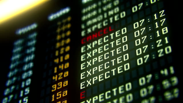 Flights canceled or delayed on information board, terrorism threat at airport video