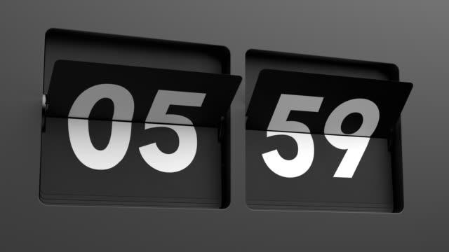 flip clock vrida långsamt från 05:59 till 06:00 - alarm clock bildbanksvideor och videomaterial från bakom kulisserna
