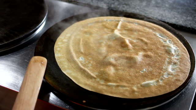 flip pancakes at professional griddle video