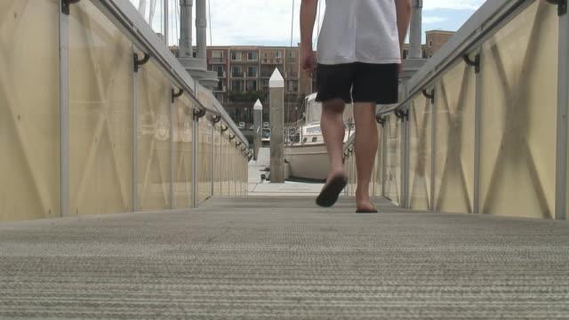 hd: flip-flops, thongs, jandals on boat dock - leaving - {{searchview.contributor.websiteurl}} stock videos & royalty-free footage